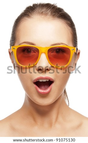 teenage girl in shades with expression of surprise - stock photo
