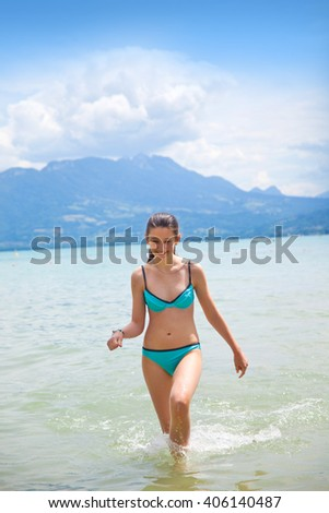 Teenage girl in the lake Annecy, France, region Houte Savoy  - stock photo