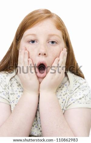 Teenage Girl Looking Shocked - stock photo