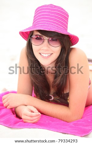 Teenage girl on the beach - stock photo