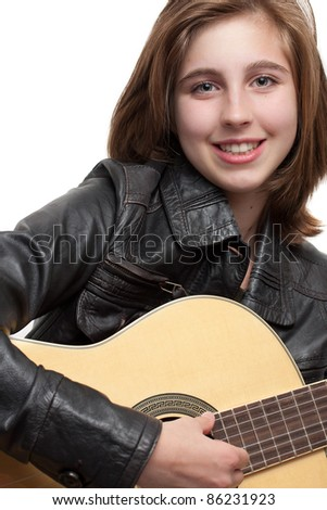 Teenage girl playing guitar, portrait - stock photo