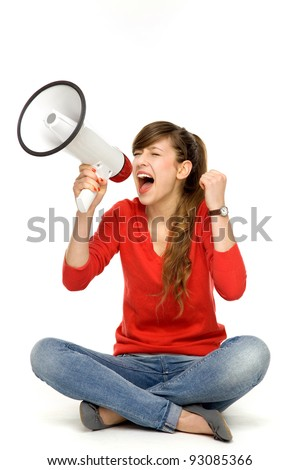 Teenage girl shouting through megaphone - stock photo