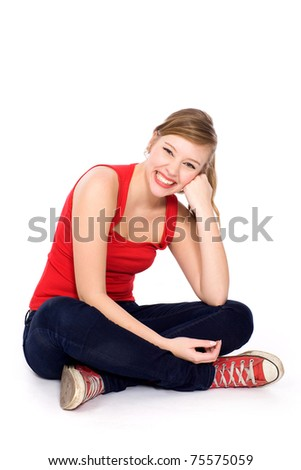 Teenage girl sitting - stock photo
