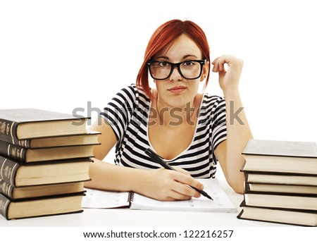Teenage girl studying at the desk being tired. Isolated on white background - stock photo