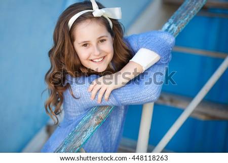 teenage girl. Style teen girl at the street. Beautiful smiling teenage girl in spring - stock photo