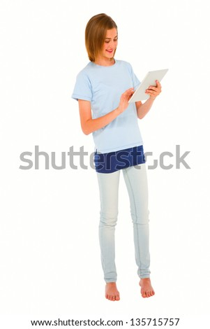 teenage girl using tablet - stock photo