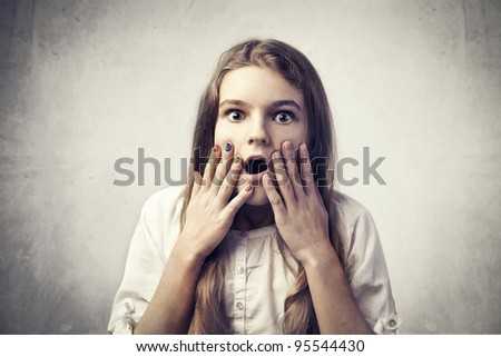 Teenage girl with astonished expression - stock photo
