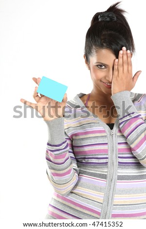 Teenage girl with blue blank credit card - stock photo