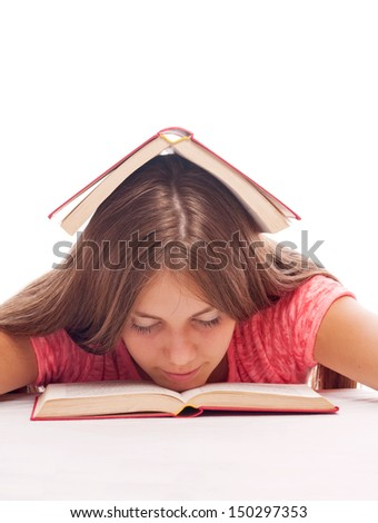 Teenage girl with book on the head sleeping on the book, on the white background - stock photo