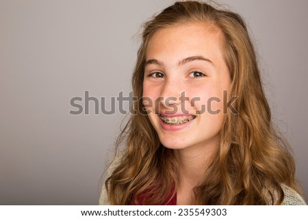 teenage girl with braces - stock photo