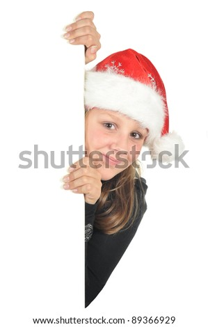 Teenage girl with Christmas hat looking around the corner (isolated on white) - stock photo