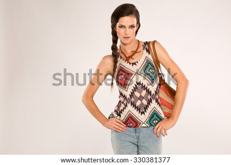 Teenage girl with ethnic and colorfull look sticks to the hips - stock photo