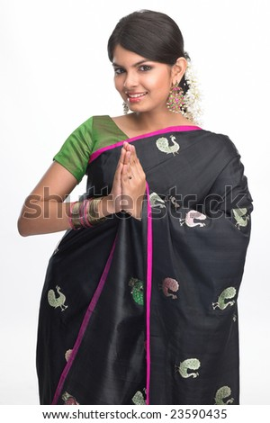 Teenage girl with fancy black sari in welcome posture - stock photo