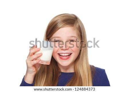 teenage girl with glass of milk and milk moustache smiling - stock photo