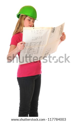 Teenage girl with green hardhat and blueprint Note for inspector: Plan is from my own house, see PR - stock photo