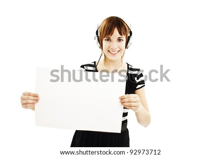 Teenage girl with headphones, holding blank sign. Isolated on white background - stock photo