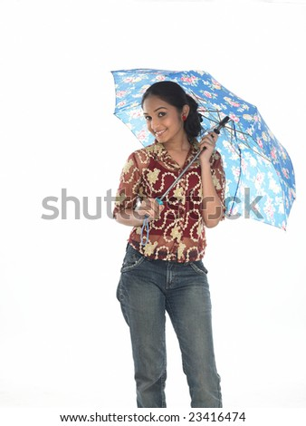 Teenage girl with modern costume under blue umbrella - stock photo