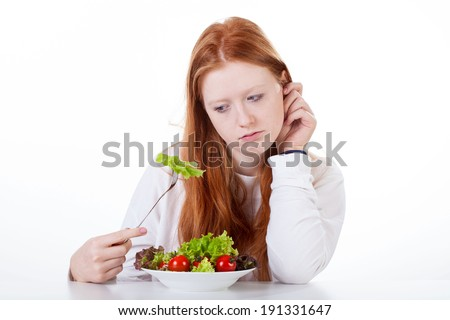 Teenage girl with no appetite on white isolated background - stock photo