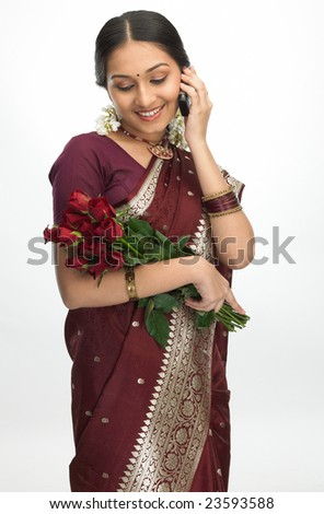 Teenage girl with the roses talking over phone - stock photo