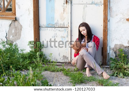 Teenage girl with toy outdoors - stock photo