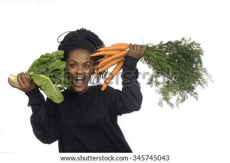 teenage girl with vegetables - stock photo