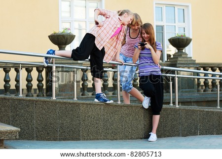 Teenage girls calling on the mobile phones - stock photo