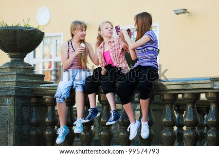 Teenage girls calling on the phones - stock photo