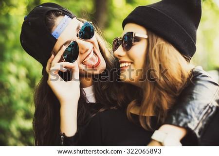 Teenage girls, having fun outdoor. Happy summer time. - stock photo