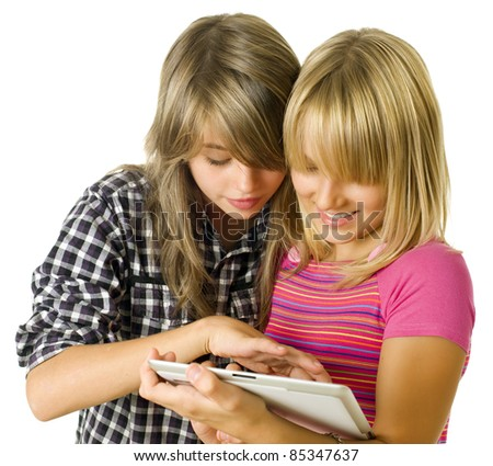 Teenage girls using touchpad. PC tablet - stock photo