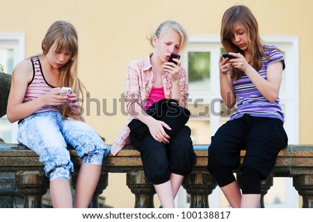 Teenage girls with a mobile phones - stock photo