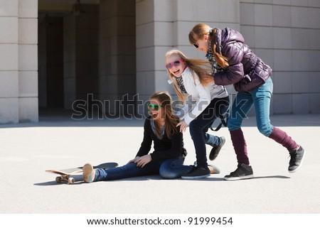 Teenage girls with skateboard - stock photo