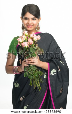 Teenage indian girl in black sari holding bunch of pink roses - stock photo