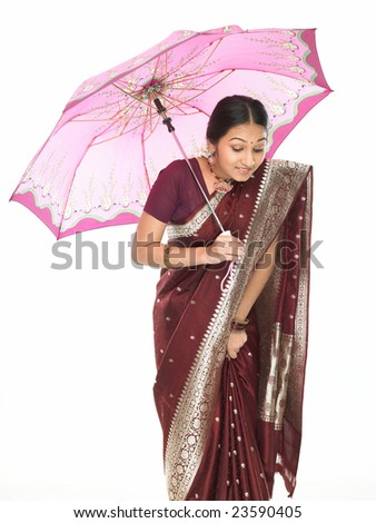 Teenage indian woman with pink umbrella - stock photo