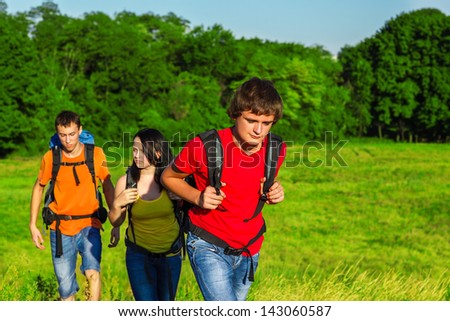 Teenage students enjoying summer vacations with backpacks - stock photo