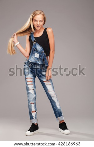 Teenage stylish girl with strong beautiful hair  - stock photo