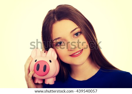 Teenage woman holding piggyback. - stock photo