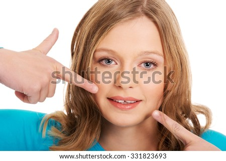 Teenage woman showing her teeth - stock photo