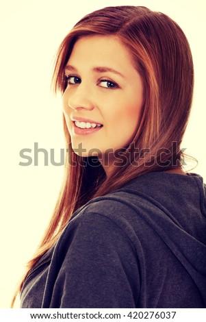 Teenage woman smiling in cheerful mood - stock photo