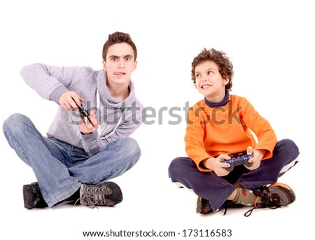 teenager and boy playing videogames isolated in white - stock photo