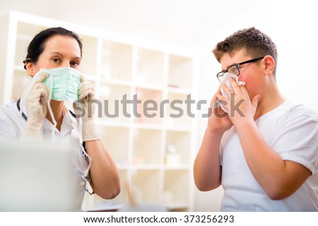 Teenager boy at the doctor for a checkup - being examined - stock photo