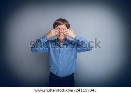 teenager boy Caucasian appearance eyes closed hands cross process - stock photo