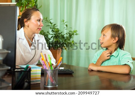 Teenager boy complaining of pain in throat to doctor - stock photo