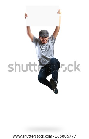 Teenager boy jumping and holding blank paper, Isolated over white - stock photo