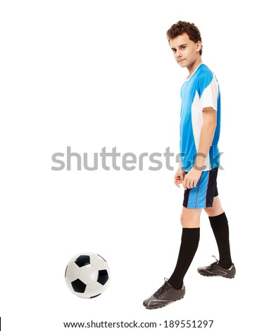 Teenager boy soccer player kicking the ball isolated on white background - stock photo