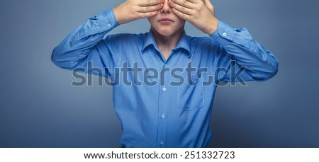 teenager boy 10 years brown hair Caucasian appearance eyes closed hands on a gray background unknown - stock photo