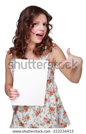 Teenager brunette curly hair girl wearing clothes with floral ornament and showing white blank card - stock photo