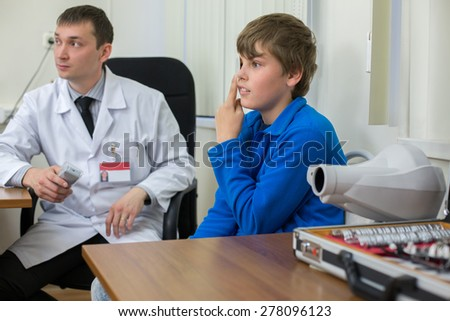 teenager checks sight at the reception of an ophthalmologist - stock photo
