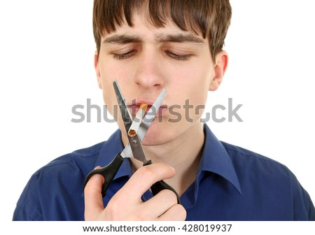 Teenager cutting a Cigarette with Scissors Isolated on the White Background - stock photo