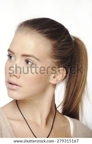 Teenager face with ponytail, isolated on white - stock photo
