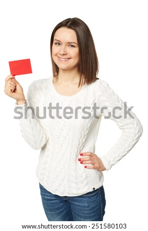 Teenager female holding empty credit card, over white background - stock photo